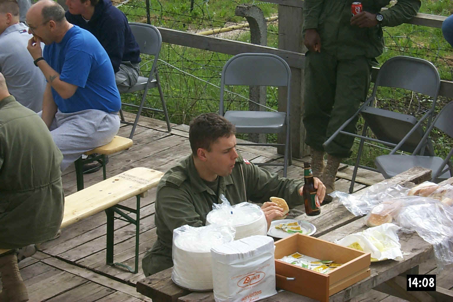 BBQ sitting with his friends.jpg (278182 bytes)